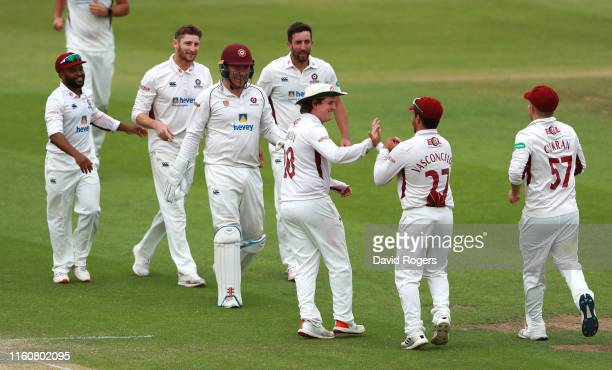 Northamptonshire players celebrate after Josh Bohannon is caught by Riccardo Vasconcelos off the bowling of Rob Keogh during the Specsavers County...