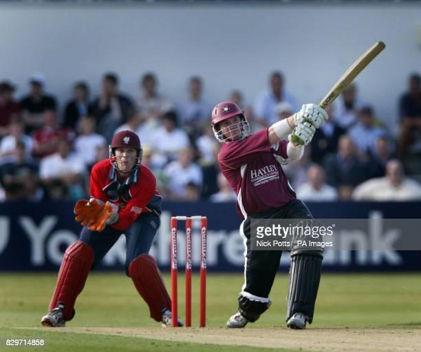 Northamptonshire Steelbacks' batsman David Sales in action while Somerset Sabers' wicketkeeper Carl Gazzard watches