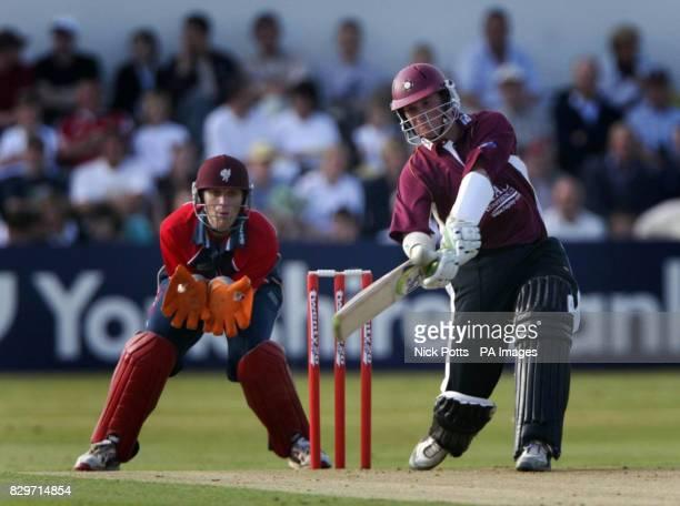 Northamptonshire Steelbacks' batsman David Sales scores runs while Somerset Sabers' wicketkeeper Carl Gazzard watches