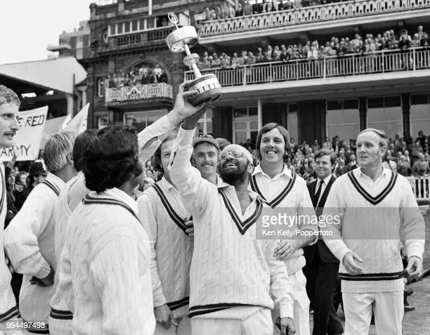 Northamptonshire's Bishan Bedi holds up the trophy as Northamptonshire celebrate winning the Gillette Cup Final against Lancashire at Lord's Cricket...