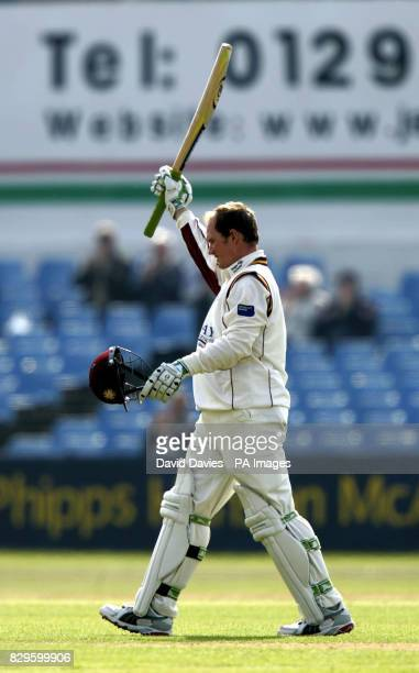 Northamptonshire's David Sales acknowledges the crowd on reaching his century during his innings of 113