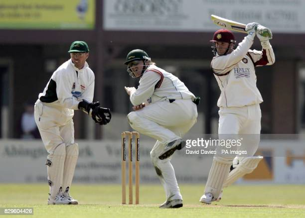 Northamptonshire's David Sales causes John Maunder of Leicestershire to take evasive action as he cuts a delivery from Claude Henderson to the...