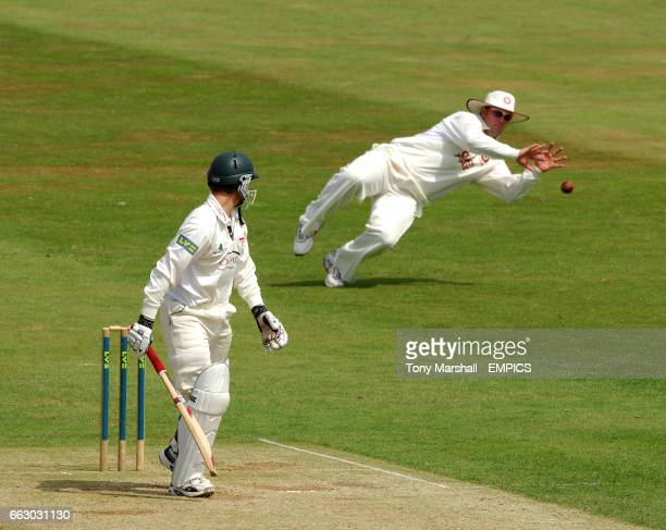 Northamptonshire's David sales dives to stop a shot from Leicestershire's Matthew Boyce