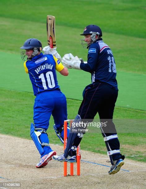 Northants keeper David Murphy looks on as Warwickshire batsman William Porterfield picks up some runs during the Friends Life T20 match between...