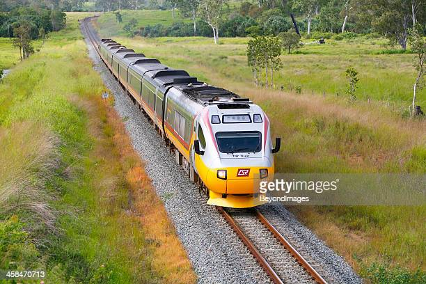 Northbound Cairns Tilt Train in remote tropical country