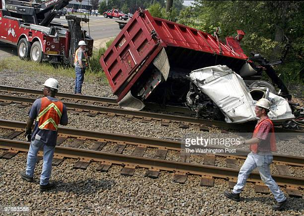 A northbound passenger train collided with a dump truck near Bristow Va and halted rail traffic for several hours At 130pm remains of the truck were...