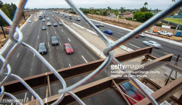 Northbound traffic on the 405 freeway, at left, passes under the new Slater Avenue bridge in Fountain Valley on Wednesday, August 28, 2019. The...