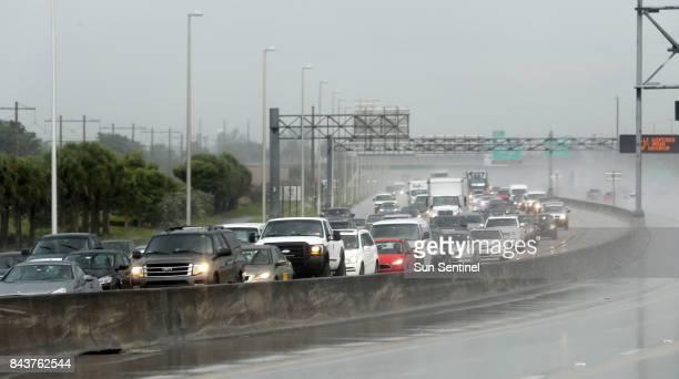 Northbound traffic on the turnpike near Sunrise Blvd. Was backing up in the rain Thursday, Sept. 7, 2017 near Sunrise, Fla.