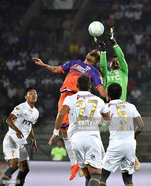 Northeast United FC's goalkeeper Subrata Paul jumps for the ball with FC Pune Citys defender Eduardo Ferreira during the Indian Super League football...