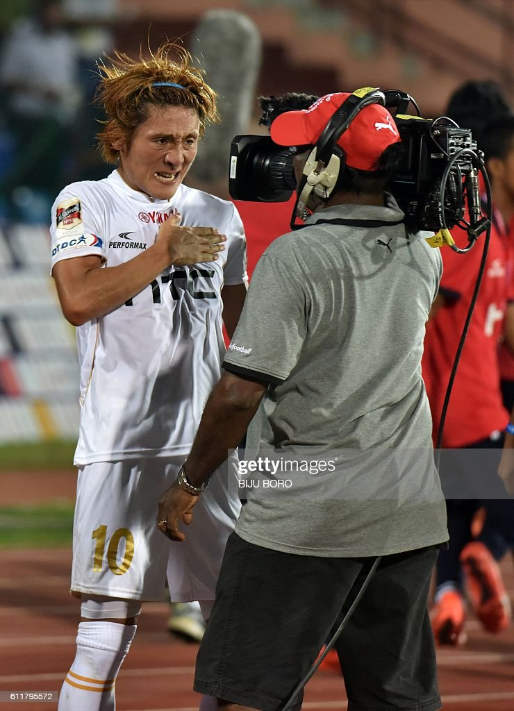 Northeast United FC's midfielder Katsumi Yusa (L) celebrates after scoring a goal during the Indian Super League (ISL) football match between Northeast United FC and Kerala Blasters FC at The Indira Gandhi Athletic Stadium in Guwahati on October 1, 2016. USE-- / AFP / Biju BORO