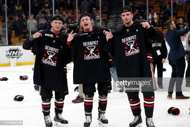 Northeastern celebrates their victory after the 2019 Beanpot Championship Game between the Boston College Eagles and the Northeastern University...