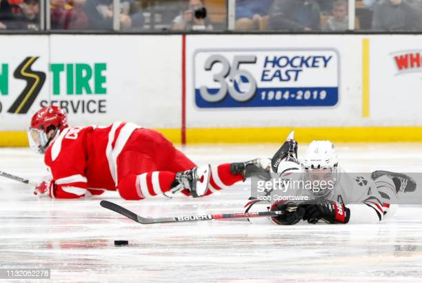 Northeastern defenseman Jeremy Davies looks for a call after being spilled by Boston University Terriers defenseman Cam Crotty during a Hockey East...