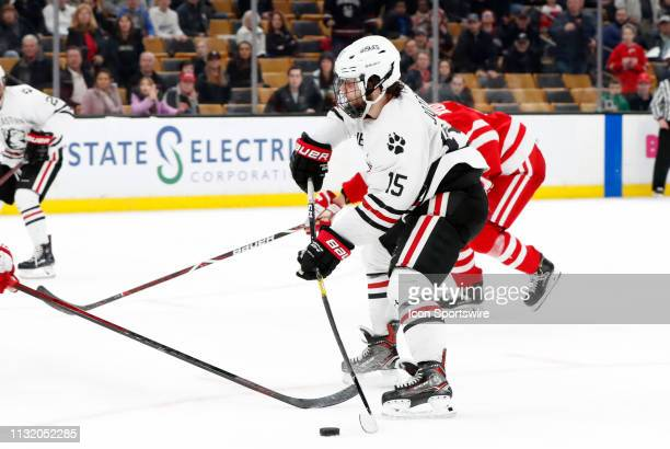 Northeastern forward Grant Jozefek tries to get a shot off during a Hockey East semifinal game between the Boston University Terriers and the...