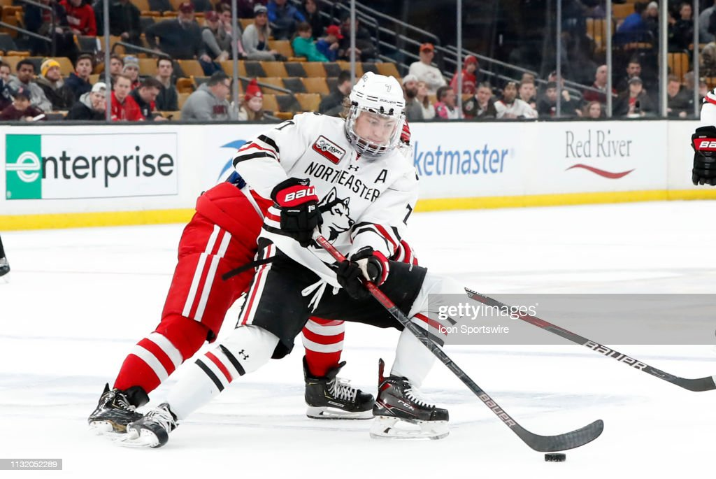 Northeastern forward John Picking holds the puck during a Hockey