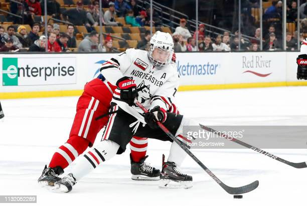 Northeastern forward John Picking holds the puck during a Hockey East semifinal game between the Boston University Terriers and the Northeastern...