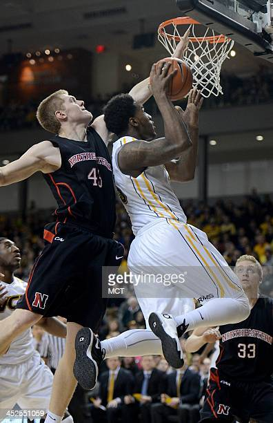 Northeastern forward Scott Eatherton fouls Virginia Commonwealth forward Juvonte Reddic during a shot attempt in the second half at the Stuart Siegel...