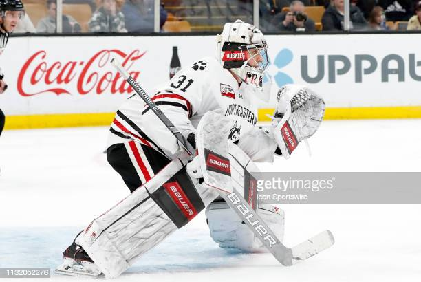 Northeastern goalie Cayden Primeau gets ready for a shot during a Hockey East semifinal game between the Boston University Terriers and the...