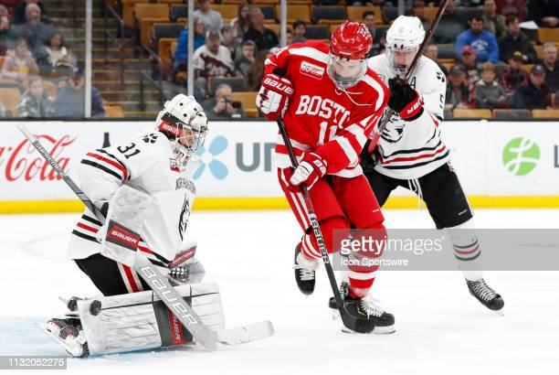 Northeastern goalie Cayden Primeau makes a right pad save with Boston University Terriers forward Patrick Curry in front during a Hockey East...