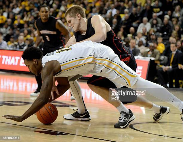 Northeastern guard Zach Stahl back fouls Virginia Commonwealth forward Juvonte Reddic during a scramble after a loose ball in the second half at the...