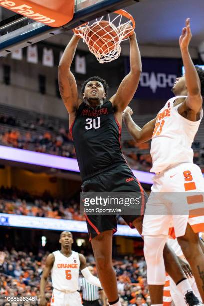 Northeastern Huskies Center Anthony Green dunks the ball with Syracuse Orange Forward Elijah Hughes defending during the first half of the...