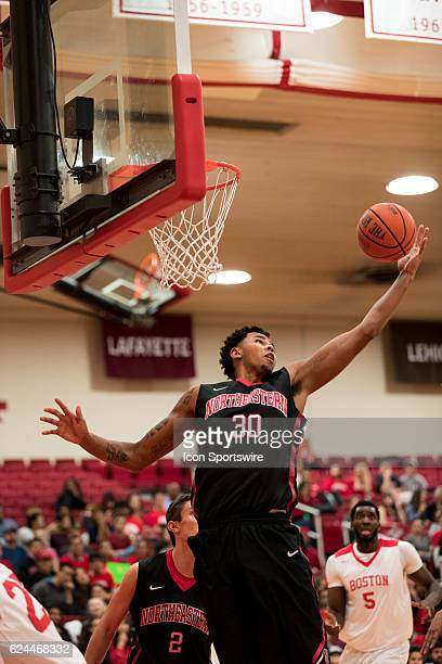 Northeastern Huskies center Anthony Green grabs a rebound during the first half of the game between the Northeastern Huskies and the Boston...