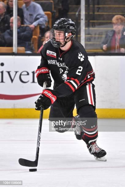 Northeastern Huskies defenseman Jordan Harris skates up ice with he puck. During the Northeastern Huskies game against the Boston University Terriers...