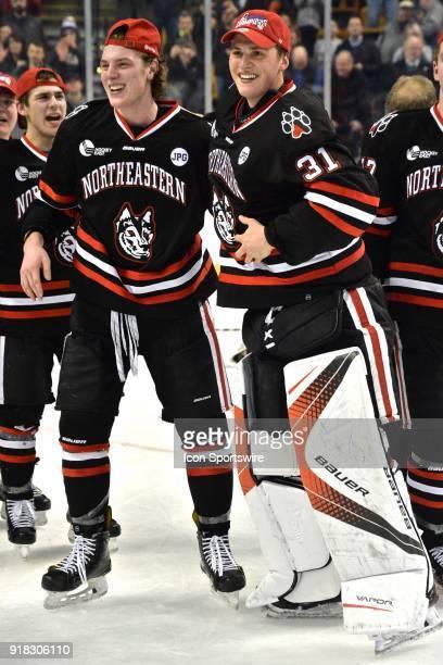 Northeastern Huskies forward Adam Gaudette and Northeastern Huskies goaltender Cayden Primeau celebrate their 5 to 2 win During the Northeastern...