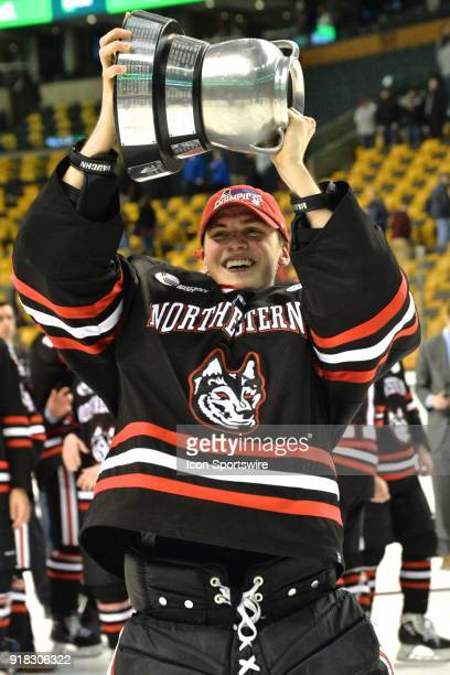Northeastern Huskies goaltender Cayden Primeau is all smiles as he raises the Beanpot Trophy During the Northeastern Huskies game against the Boston...
