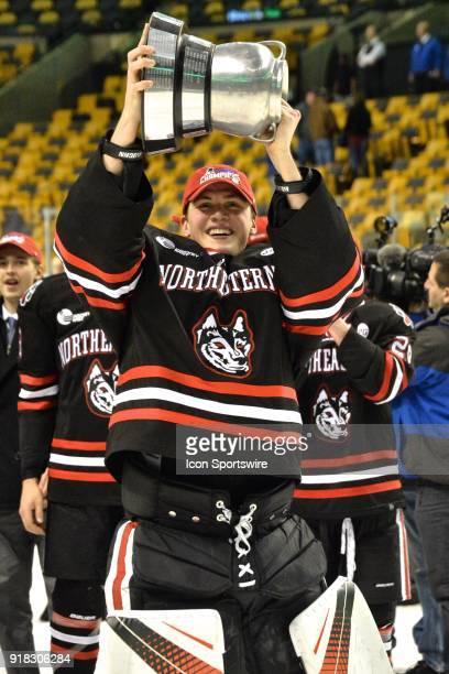 Northeastern Huskies goaltender Cayden Primeau raises the Beanpot Trophy During the Northeastern Huskies game against the Boston University Terriers...