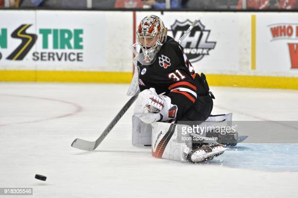 Northeastern Huskies goaltender Cayden Primeau watches the puck sail past the net During the Northeastern Huskies game against the Boston University...
