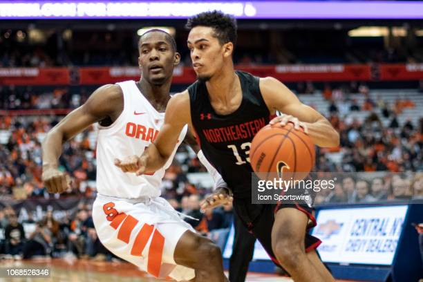 Northeastern Huskies Guard Myles Franklin dribbles the ball against Syracuse Orange Guard Jalen Carey defending during the first half of the...