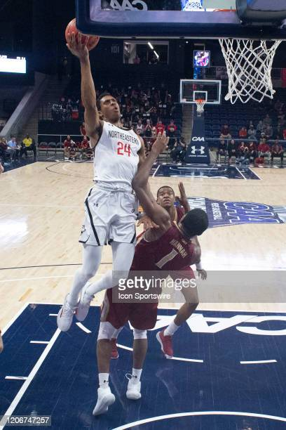 Northeastern Huskies Guard Shaquille Walters shoots a layup with Elon Phoenix Forward Chuck Hannah defending during the second half of the Colonial...