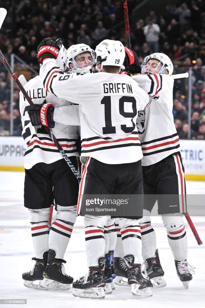 Northeastern Huskies players celebrate a goal  During the