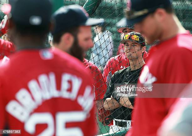 Northeastern infielder Keith Kelly of Shrewsbury Mass watches as the Red Sox including Jackie Bradley Jr Dustin Pedroia and Will Middlebrooks take...