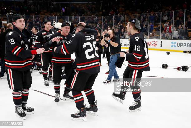 Northeastern players celebrate winning their second Beanpot in a row during the 2019 Beanpot Championship Game between the Boston College Eagles and...