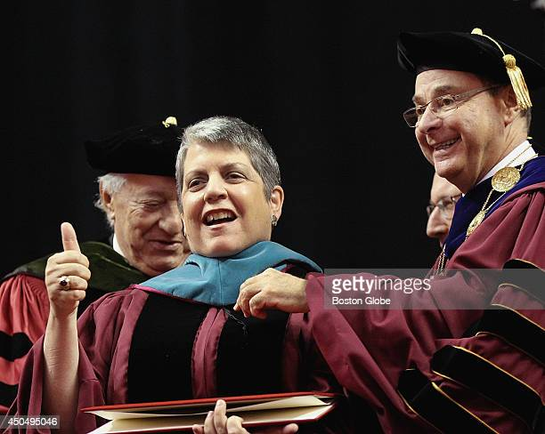 Northeastern University President Joseph E Aoun right looked on as former US Secretary of Homeland Security Janet Napolitano middle received an...