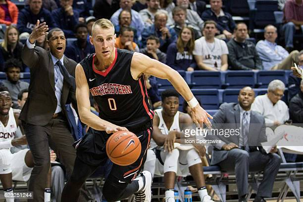 Northeastern's Forward Alex Murphy works into the paint during the first half of a men's NCAA division 1 basketball game between the Northeastern...