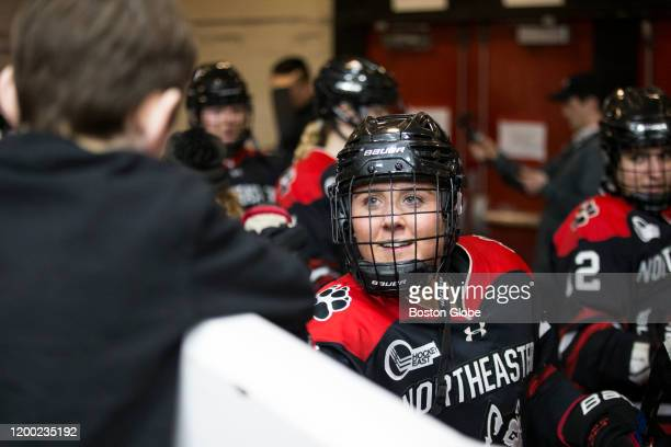Northeastern's Katie Cipra fist bumps a fan before entering the ice. The Boston University Terriers play the Northeastern Huskies in the women's...