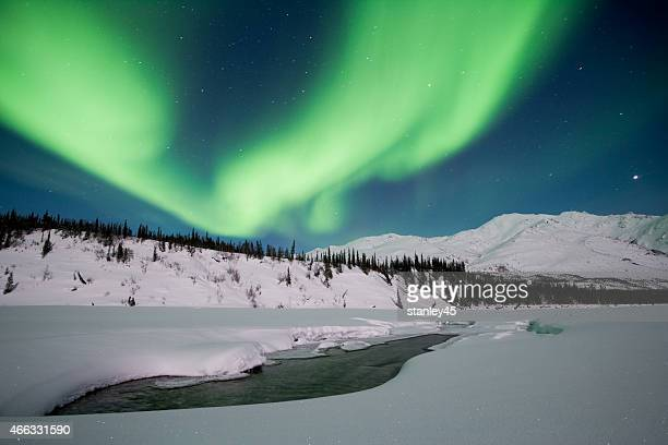 Northen Lights above Winter Mountains