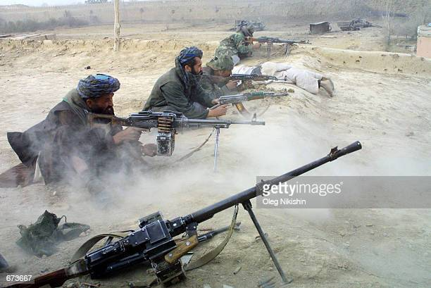 Northern Alliance fighters battle pro-Taliban forces November 27, 2001 in a fortress near Mazar-e-Sharif, Afghanistan. The Northern Alliance, helped...
