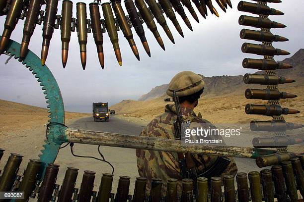 Northern Alliance soldier stands guard at a checkpost as a German military convoy heads towards Kabul January 11 2002 after arriving at Bagram...
