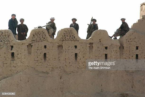 Northern Alliance Soldiers Patrol On The Fortress On November 27 2001 In Qalaijangi Afghanistan