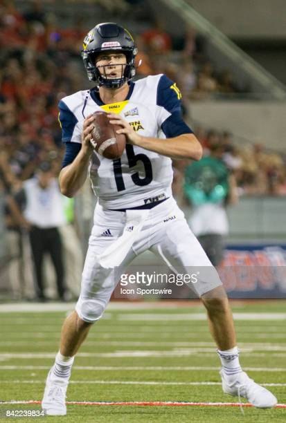 Northern Arizona Case Cookus Looks to throw the ball during a college football game between the Northern Arizona Lumberjacks and Arizona Wildcats on...