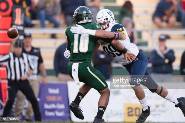 Northern Arizona Lumberjacks defensive lineman Carson Taylor hits Cal Poly Mustangs quarterback Khaleel Jenkins as he passes the ball during the game...
