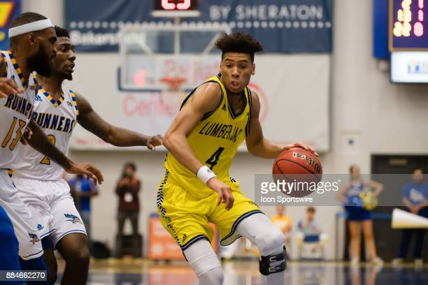 Northern Arizona Lumberjacks guard Jojo Anderson drives the ball up the middle of the court during the game between the Cal State Bakersfield and...