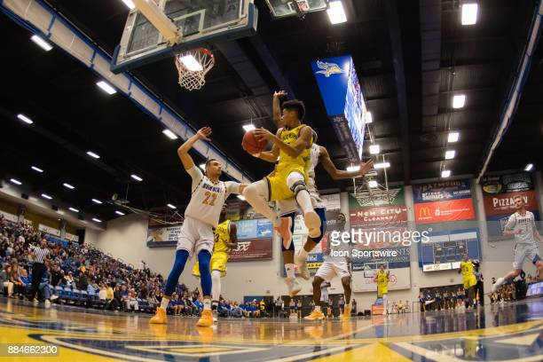 Northern Arizona Lumberjacks guard Jojo Anderson takes the ball to the basket during the game between the Cal State Bakersfield and Northern Arizona...