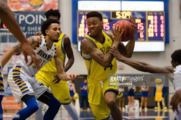 Northern Arizona Lumberjacks guard Karl Harris drives the ball to the basket during the game between the Cal State Bakersfield and Northern Arizona...
