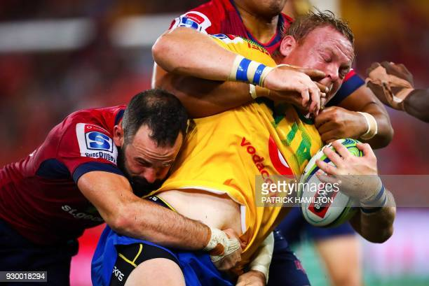 TOPSHOT Northern Bulls' Adriaan Strauss is tackled by Queensland Reds' Jono Lance during the Super Rugby match between Australia's Queensland Reds...