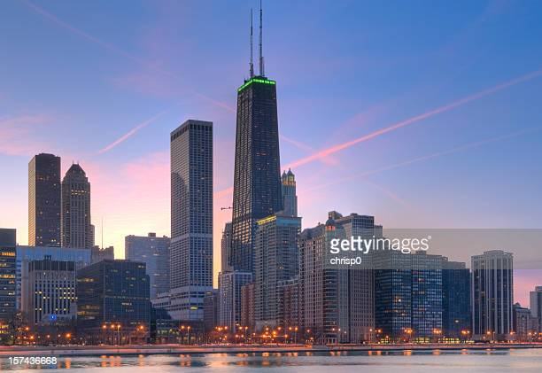 northern chicago skyline at sunset - hancock building chicago stock photos and pictures