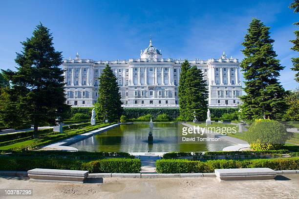 northern facade of palacio real (royal palace) seen from jardines de sabatini. - madrid royal palace stock pictures, royalty-free photos & images